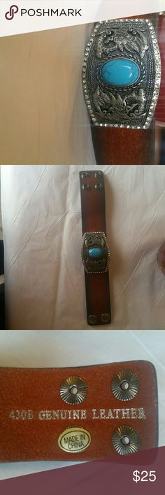 Genuine leather and turquoise bracelet Genuine leather bracelet with turquoise and rhinestones very nicely crafted double snaps too big for me nwot. Measurement are 8 1/2  inches to second snap and 7 1/2 to first it is 3 1/2 inches width. Jewelry Bracelets