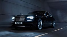 Rolls Royce Wraith Black Badge. Taking the most powerful 6.6L V12 Rolls Royce to new heights by intensifying it with the a new transmission to deliver more torque (870Nm). And the stunning black carbon-fibre interior and wheels doesn't hurt.