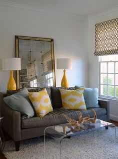 House of Turquoise: Nancy Twomey + Jamie Salomon - gray sofa, yellow and blue pillows and cheery yellow lamps