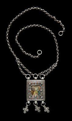 Iraq | Necklace worn by the Christian women of Qaraqoch, a small town located a few kms from Mosul, Ninawa | Silver, chromolithograph under glass | ca. 20th century