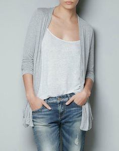 Wrap your plain white shirt with a gray cardigan.