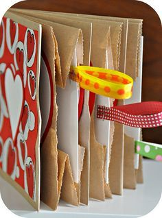 Valentine Paper Bag Books. How cool. You need three paper bags and come scraps of paper and ribbon and your child's imagination for this project! The pin leads you to Rosy-Posy's blog with step by step instructions.