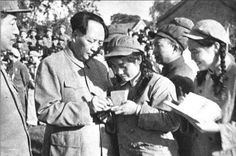 Female soldiers back from Korean front sought autographs from Chairman Mao.