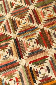 On patchwork, handsewn quilts, patterns, lots of fabrics and scraps, our company EQP Textiles, our cat Thijs and much more! - Ellen