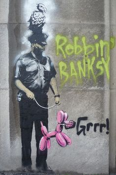 Graffiti/street art by Banksy-Toronto 2010...words and bird added by someone else