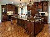 Large Island with sink and dishwasher - traditional - kitchen - minneapolis - by Ehlen Creative Communications