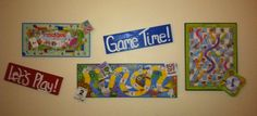 Reused kids games that don't have all the pieces anymore. Hot glue playing pieces to game board for 3D look. Secure game to 1x1 wood along the back. Game board sticks out slightly from wall. Cute toy room decorations