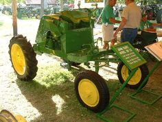 Did you know John Deere in 1941 created a Full Vision Tractor called the EX 101! Unconventional tractors were common in John Deere's engineering offices. One of the company's more creative engineers, Theo Brown, recognized that the general-purpose tractors intended for cultivating single rows had acommon fault.  The power plant of the tractors was between the operator and the row to be cultivated. In 1941, he introduced a new concept at John Deere - the Full Vision tractor.
