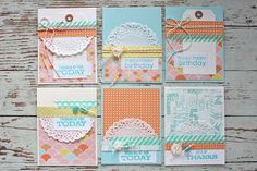 Beautiful layered cards with doilies and stamped messages.  Stitching, too!