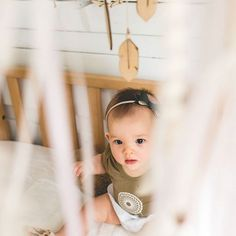 This cutie's pictures never get dull! Her mom always photographs such amazing shots. Our site has several onesies made of this incredible soft bamboo cotton in different colors. Clean designs and boho inspired make these Bambooloui bodysuits hard to keep on our shelves!