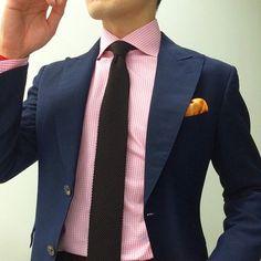 blue linen blazer. pink gingham shirt. black knit tie. golden yellow pocket square. sleek. modern. style.
