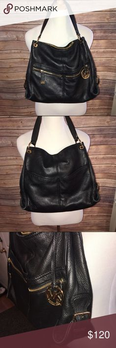 "Michael Kors Black Bucket Bag with Gold Accents Gorgeous and buttery soft black leather bucket style badge with Gold zipper and buckle accents. Perfect size, 14"" long, 12"" wide, with 9"" strap drop. Perfect condition, no flaws at all. Check out my other listings to bundle and save 25% 😎! Michael Kors Bags Hobos"
