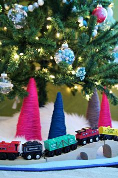 yarn wrapped cones with wooden train super cute christmas tree train christmas tree