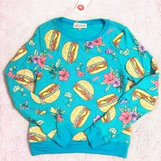 "NWT Wildfox Hamburger Floral Baggy Beach Jumper Brand new with tag authentic Wildfox baggy beach jumper. Cheeseburger in paradise. Deliciously soft fleece pullover sweater featuring a relaxed and roomy fit. Scoop neck and banded hems. Turquoise color with multicolor burger and floral print on front and back. Size XS, approx 25"" long, 18"" across chest. ❌No trades❌Price firm unless bundled. Wildfox Sweaters Crew & Scoop Necks"