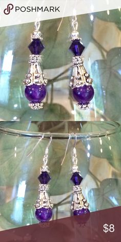 Amethyst Swarovski crystal earrings These are made with 925 Sterling silver ear wires. They have Russian amethyst beads, purple Swarovski crystal and and antique silver caps. These hang 1 1/2 inches. Handmade by me. This is my bottom price. I now have the plastic earring stoppers Jewelry Earrings