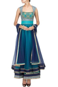 Featuring a midnight blue and turquoise layered tulle anarkali with a digitally printed bodice highlighted with hand embroidery and a stitch line detailed waist belt. It has a deep back and attached c