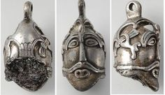 10th century Viking silver pendant from Aska in Hagebyhöga parish, Östergötland, Sweden The pendant is a male head with bird on top with its wings spread down to the ears. This comes from a woman's...