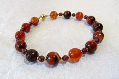 Agate and Garnet Bracelet with Gold Accents by BellaDivaBeads
