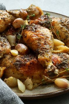 "NYT Cooking: This is a recipe I picked up from Steven Stolman, a clothing and interior designer whose ""Confessions of a Serial Entertainer"" is a useful guide to the business and culture of dinner parties and general hospitality. It is a perfect dinner-party meal: chicken thighs or legs dusted in flour and roasted with shallots, lemons and garlic in a bath of vermouth and under a ..."