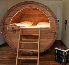 Bed built inside large wine barrel.  I don't think I could sleep- I would be giggling too much!