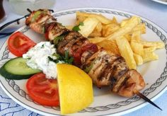 For a great, Greek dish straight from the grill, why not try a fantastic pork souvlaki? It's small pieces of marinated pork grilled on a skewer served with pita and tzatziki sauce. Grilling Recipes, Pork Recipes, Chicken Recipes, Cooking Recipes, Healthy Recipes, Cooking Games, Ribs, La Trattoria, Gastronomia