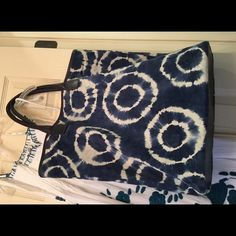 Flora Bella Tie Dyed Leather Large Tote BOGO $5 Flora Bella Tie Dyed Large Tote in Blue and White. Tanned and Processed to a Very Thin Cut and Butter Soft to Touch Quality. 100% Sueded Leather. Size is 17 Inches Tall, 14 Inches Long and 6 Inches Wide. Like New Condition with Dust Bag and A few One to Two millimeter Pinhole Frays in the Leather and/or Discolorations that can only be seen Nose Breath from the Bag. Smoke And Pet Odor Free Home. Flora Bella Bags Totes