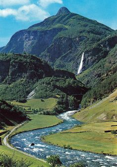 View from Flam Railway towards Mount Vibmesnosi and Rjoandefossen Waterfall, Norway