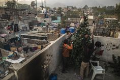 Merry Christmas! Pakistani Christian boys decorate a Christmas tree on the roof of their house in Islamabad, Pakistan on Dec. 16, 2013. - Found via Buzzfeed