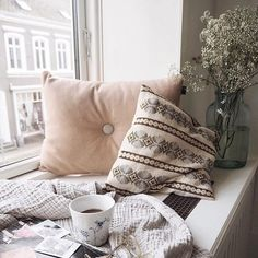 Our #WednesdayWisdom is make sure you have a cosy space in your home where you can day dream and escape the everyday! :: This corner is the definition of #Hygge with blankets pillows & hot chocolate to keep you warm this winter. Featuring the Hay Dot cushion. :: credit : @isabellath