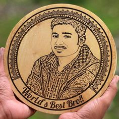 Description World's Best Bro Wooden Photo Frame The world's best brother deserves a personalized wooden frame made especially for him. Your brother may annoy you to no end but he will protect you from the worst, hear you out when you need someone to listen to you, help you take major life decisions, and will love you unconditionally. He will never desert you and will support you unquestioningly. Let your brother know that he is the world's best bro with this wood engraved photo. Gift your brothe Photo Engraving, Wood Engraving, Wooden Plaques, Wooden Frames, Laser Engraved Gifts, Rakhi Gifts, Portrait Pictures, Life Decisions, Best Birthday Gifts