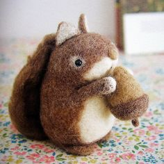 adorable felt squirrel with acorn from a japanese craft book by feltcafe, via Flickr