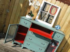 This very narrow breakfront buffet has what would have been a pull out desk or secretary in the top middle drawer. I removed the little cubbies and it would now be ideal for a media center. The interior has been painted in tomato red that pairs so well with the muted turquoise and peeks through the heavy wire doors. Modern Vintage Diy Furniture Projects, Upcycled Furniture, Furniture Making, Furniture Makeover, Cool Furniture, Painted Furniture, Sideboard Furniture, Upholstered Furniture, Distressed Furniture