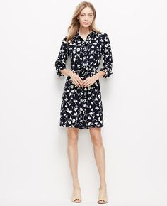 """Strewn in spring florals, our signature shirtdress is always ready to flourish. Point collar. Long sleeves with button tabs. Button front. Self tie belt. Back yoke with box pleat. Shirttail hem. 21 1/2"""" from natural waist."""