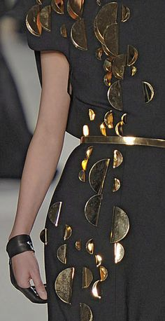 Black & gold dress with 3D folded metallic disc detail - alternative surfaces; close up fashion details // Stephane Rolland