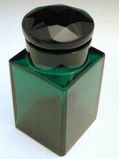Wiener Werkstatte Silver & Glass Scent Bottle by Josef HOFFMANN. Green glass scent bottle w/ silver mount. Austria c.1905. Marks: WW mark and Austrian poincon. (hva)