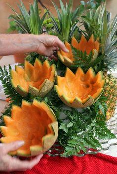 cascading fruit displays   Arrange large leatherleaf ferns on tall, ?back? side of the ...