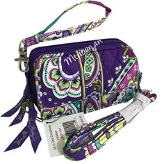 """Vera Bradley All In One Crossbody Wallet Vera Bradley All In One Crossbody Wallet/Wristlet Heather  Dimensions: 5½"""" W x 3½"""" H x 2"""" D with 52"""" removable, adjustable strap & 6"""" removable wrist strap  • Front magnetic pocket is a perfect fit for most cell phones • One zippered compartment houses two slip pockets & a zippered coin pocket • A second zippered compartment includes a large bill pocket, six credit card slots & an ID window   I have more VERA BRADLEY!  ❌ NO TRADES ❌ PRICE FIRM…"""