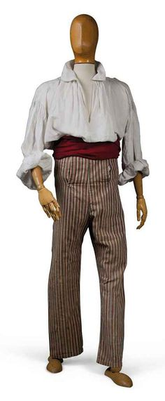 Pair of pantaloons, France, late 18th century. Striped in patriotic 'revolutionary' colours in red, blue and white, fall front, buttoned.