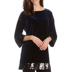 Make a statement with this long velvet tunic. This tunic features sequined hem and sleeves. The slit detail at the sides and 3/4-length bell sleeves complete the look.