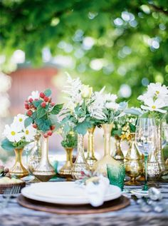 Mixed gold vases and fresh summer florals by Kunstgärtner Doll Salzburg