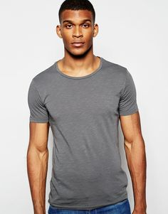 """T-shirt by United Colors of Benetton Cotton, slub jersey Round neck Regular fit - true to size Machine wash 100% Cotton Our model wears a size Medium and is 188cm/6'2"""" tall"""