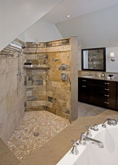 New open spa shower featuring island stone floor and border with slate stone tile.
