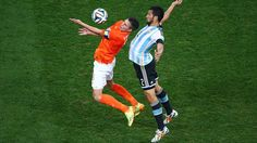 2014 FIFA World Cup™ - Photos - FIFA.com  Robin van Persie of the Netherlands and Ezequiel Garay of Argentina compete for the ball