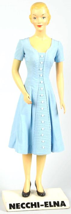 March 30th Auction. 1950s Necchi-Elna Sewing Advertising Figure. Made of hard rubber composition, cloth and wood. #NecchiElna #Advertising #MorphyAuctions