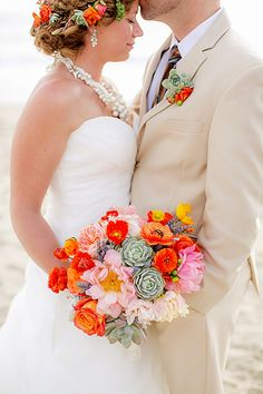 If you want your wedding to feel festive and fun, then a vibrantly-colored bouquet is a natural choice. We're seeing an explosion of hot pinks and oranges, with multicolor arrangements reserved for the most daring brides.