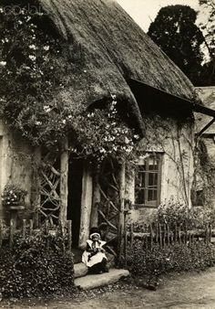 """Someone labeled this """"In rural England, a child sits outside an old English cottage."""" I think the child has on a Welsh costume so it wouldn't be England - it is the beautiful country of Wales! Witch Cottage, Cozy Cottage, Cottage Style, Old Pictures, Old Photos, Vintage Photos, English Village, England, English Countryside"""