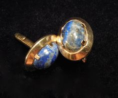 Swank Cufflinks in Laspis Lazuli set in classic oval of gold toned metal. Swank mark on the back of the cufflink. Vintage piece, lovely gift