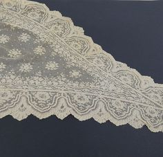 A large quantity of handmade lace flounces and tri