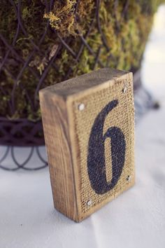 Burlap and wood table number // Photographer: Reign 7 Photography, Venue: Gasparilla Inn & Club, Flowers & Decor: Botanica International Design Studio // see more: http://theeverylastdetail.com/2013/08/28/timeless-garden-inspired-aqua-peach-wedding/