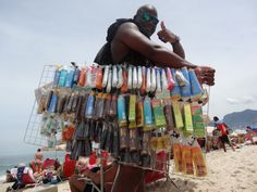 One of the many vendors on Ipanema Beach.  They sell food, drinks (including alcohol), clothing, beach blankets, hat, etc. This guy is selling every conceivable type of sunscreen!